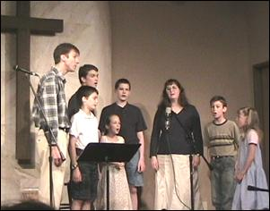 "Nate Wilson Family singing ""None Other Lamb"" at Faith E. Free church, Manhattan, KS"